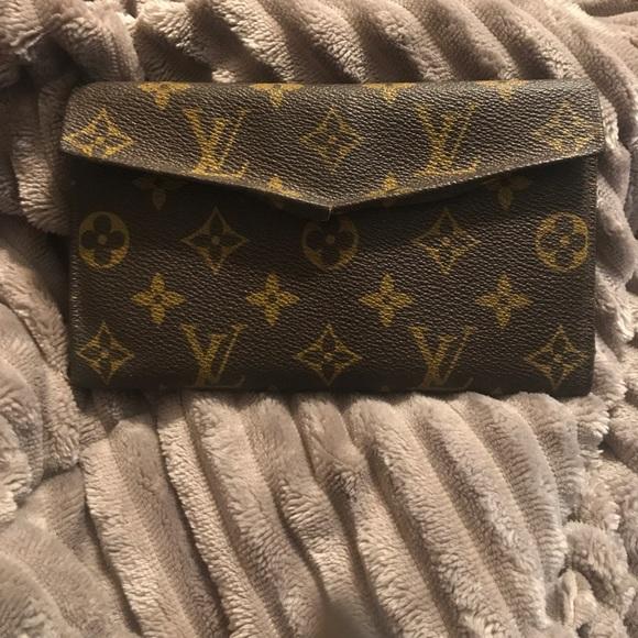 eb4cb4acb3a Vintage Authentic Louis Vuitton Saks Fifth wallet!